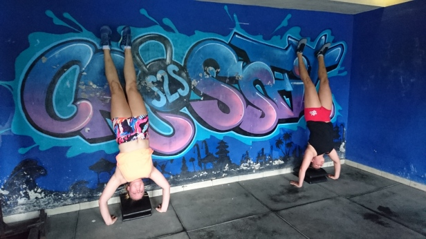 Jess and Kim doing hand stand holds